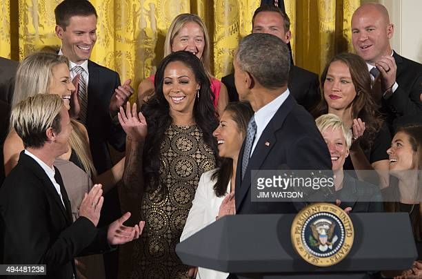 US President Barack Obama congratulates Sydney Leroux on her recent marriage during an event honoring members of the 2015 Women's World Cup soccer...