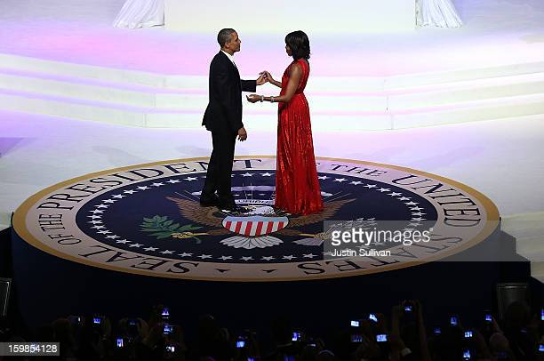 S President Barack Obama dances with first lady Michelle Obama at the CommanderinChief Ball on January 21 2013 in Washington DC Pres Obama was...