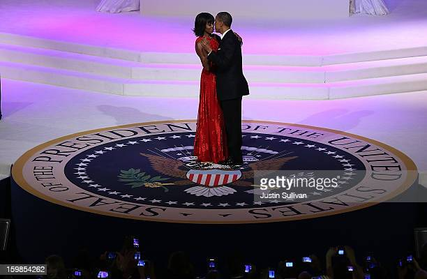 S President Barack Obama dances with first lady Michelle Obama at the CommanderinChief Ball on January 21 2013 in Washington DC Obama was swornin for...