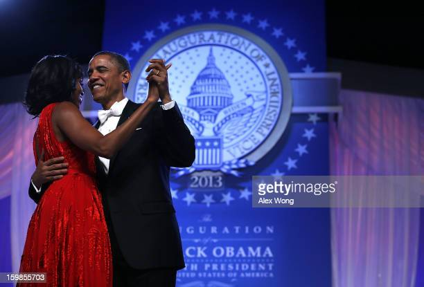 S President Barack Obama dances with first lady Michelle Obama during the CommanderinChief's Inaugural Ball January 21 2013 at Walter E Washington...