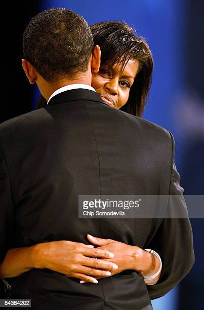 US President Barack Obama dances with his wife and First Lady Michelle Obama during the Western Inaugural Ball on January 20 2009 in Washington DC...