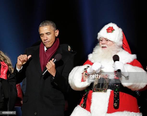 S President Barack Obama dances with Santa Claus during the lighting of the National Christmas tree on December 4 2014 in Washington DC The tree...