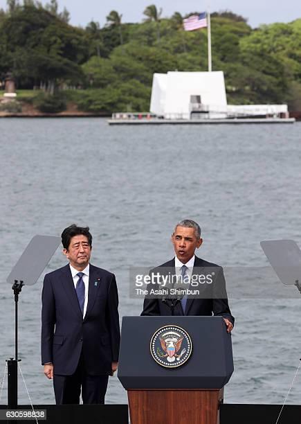 US President Barack Obama deliver remarks while Japanese Prime Minister Shinzo Abe listens at the Joint Base Pearl Harbor Hickam's Kilo Pier on...