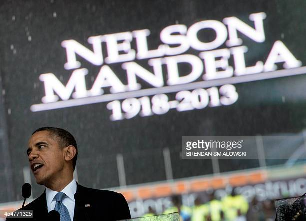 US President Barack Obama delivers a speech during the memorial service for late South African President Nelson Mandela at Soccer City Stadium in...
