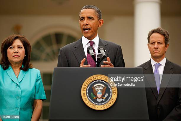 S President Barack Obama delivers a statement on the economy while flanked by Labor Secretary Hilda Solis and Treasury Secretary Timothy Geithner in...