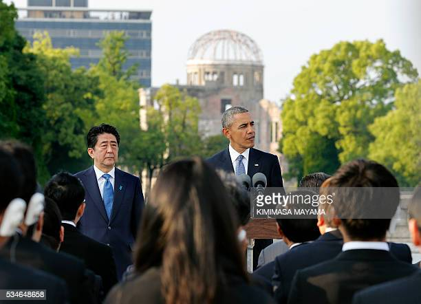 US President Barack Obama delivers his speech next to Japanese Prime Minister Shinzo Abe after laying wreaths at the cenotaph to offer a prayer for...