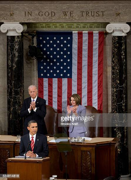 US President Barack Obama delivers his State of the Union address as Vice President Joe Biden and House Speaker Nancy Pelosi applaud in the US...