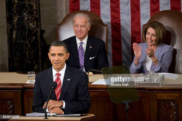 US President Barack Obama delivers his State of the Union address as Vice President Joe Biden and House Speaker Nancy Pelosi listen in the US Capitol...