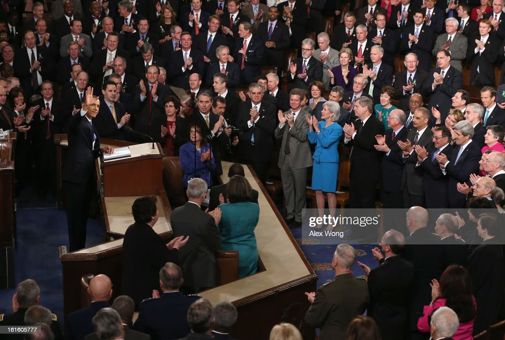 U.S. President Barack Obama delivers his State of the Union speech before a joint session of Congress at the U.S. Capitol February 12, 2013 in Washington, DC. Facing a divided Congress, Obama focused his speech on new initiatives designed to stimulate the U.S. economy and said, 'It's not a bigger government we need, but a smarter government that sets priorities and invests in broad-based growth'.
