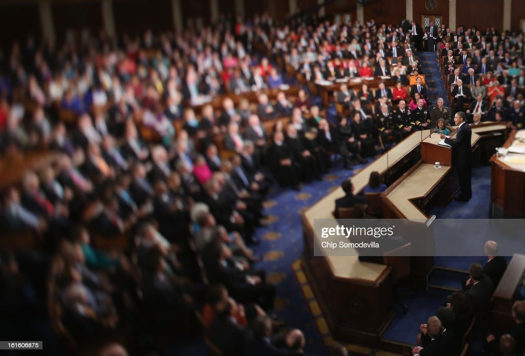 U.S. President Barack Obama (C) delivers his State of the Union speech before a joint session of Congress at the U.S. Capitol February 12, 2013 in Washington, DC. Facing a divided Congress, Obama concentrated his speech on new initiatives designed to stimulate the U.S. economy and said, 'It's not a bigger government we need, but a smarter government that sets priorities and invests in broad-based growth'.
