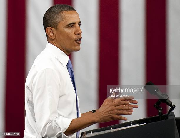 US President Barack Obama delivers remarks at Johnson Controls Inc an advanced battery facility in Holland Michigan August 11 2011 Obama takes his...