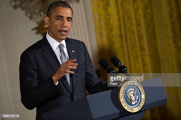 US President Barack Obama delivers remarks during a Cinco de Mayo reception on May 5 2014 in the East Room of the White House in Washington DC Cinco...