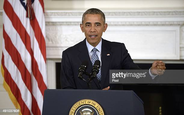President Barack Obama delivers remarks during a press conference in the State Dining Room at the White House October 2, 2015 in Washington, DC....