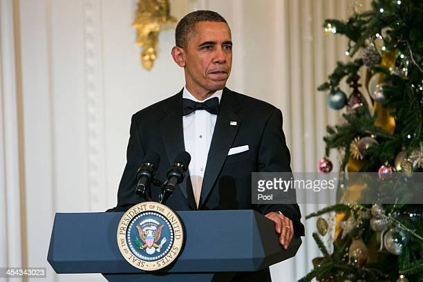 President Barack Obama delivers remarks during a reception at the White House for the 2013 Kennedy Center Honorees on December 8 2013 in Washington...
