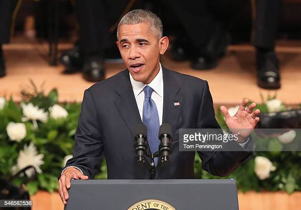 S President Barack Obama delivers remarks during an interfaith memorial service honoring five slain police officers at the Morton H Meyerson Symphony...