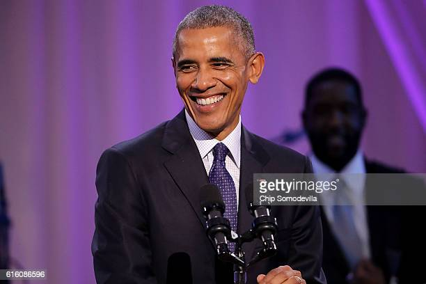 S President Barack Obama delivers remarks during the BET's 'Love and Happiness A Musical Experience' in a tent on the South Lawn of the White House...