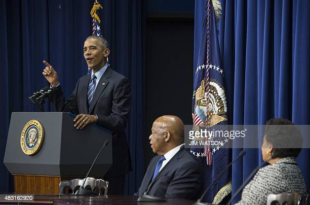 US President Barack Obama delivers remarks marking the 50th anniversary of the Voting Rights Act in Washington DC August 6 with US Attorney General...