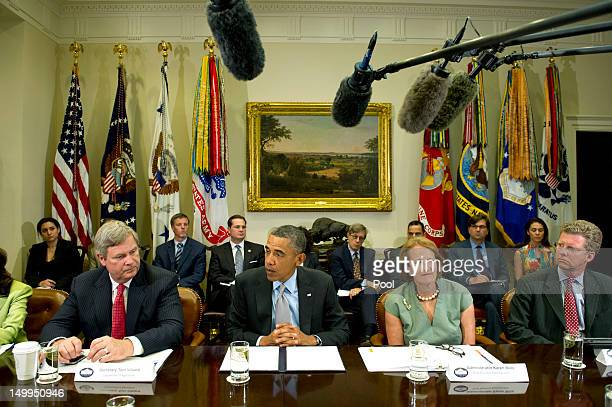 S President Barack Obama delivers remarks to the media with Agriculture Secretary Tom Vilsack Small Business Administration Administrator Karen Mills...