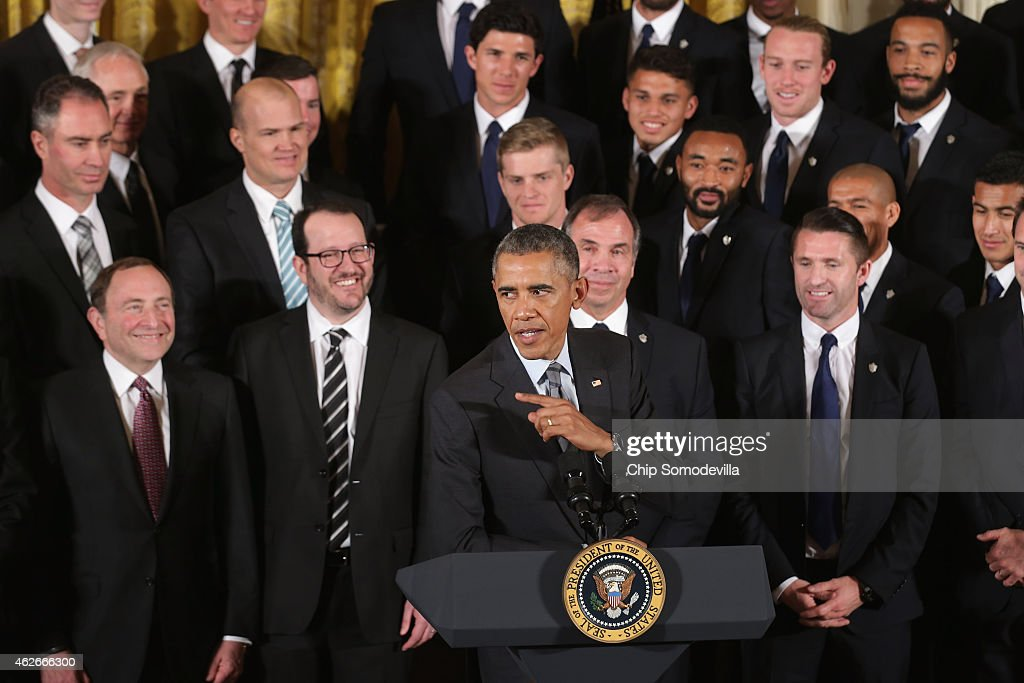 U.S. President Barack Obama delivers remarks while hosting the National Hockey League champions Los Angeles Kings and the Major League Soccer champions Los Angeles Galaxy in the East Room of the White House February 2, 2015 in Washington, DC. This was the first time that Obama had hosted two champions from different leagues to celebrate their victories at the same time.