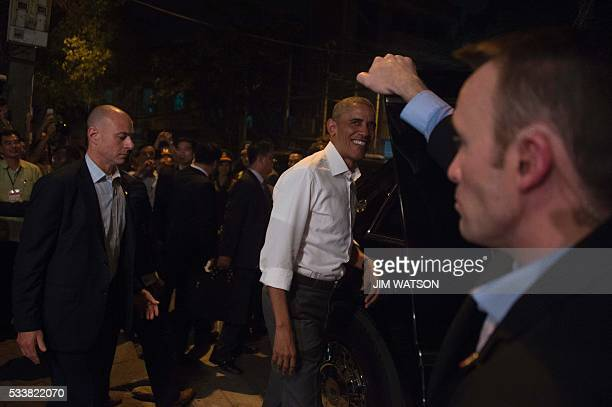 US President Barack Obama departs after eating dinner at Bun cha Huong Lien with CNN's Anthony Bourdain in Hanoi late on May 23 2016 Obama praised...