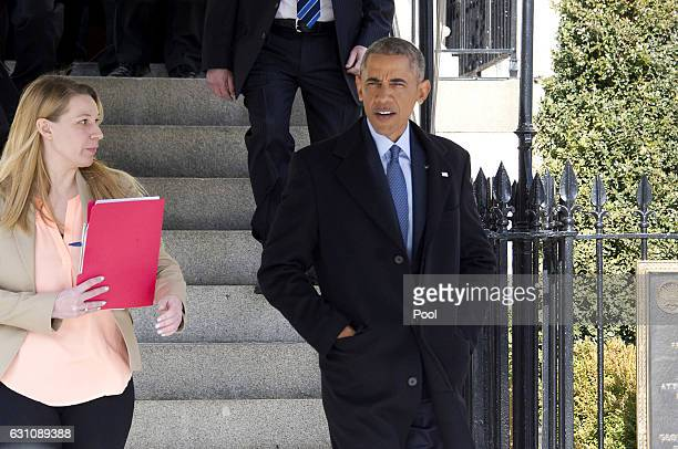 US President Barack Obama departs Blair House to walk back to the White House following his interview with Vox on January 6 2017 in Washington DC...