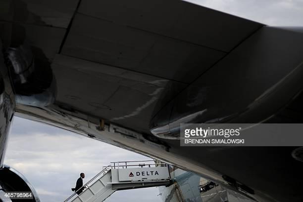 US President Barack Obama departs HartsfieldJackson Atlanta International Airport March 10 2015 in Atlanta Georgia Obama traveled to southern Georgia...