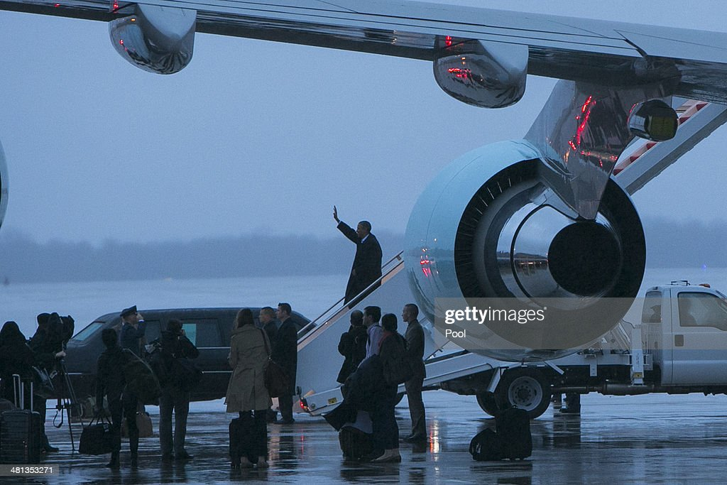 President Barack Obama disembarks Air Force One after returning from a trip to Europe and Saudi Arabia on March 29, 2014 at Joint Base Andrews in Maryland. Obama traveled to Europe as part of a series of institutional meetings which began in The Hague on March 24 with a summit on nuclear security.