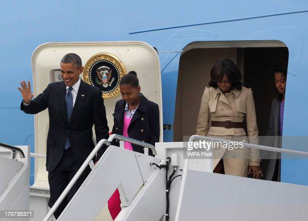 S President Barack Obama disembarks from Air Force One with his wife Michelle and his daughters Sasha and Malia upon arrival at Belfast International...