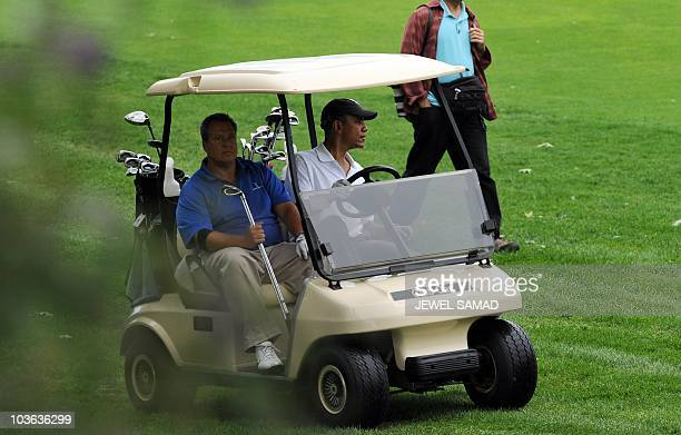 US President Barack Obama drives a golf cart as he plays golf in Vineyard Haven on Martha's Vineyard Massachusetts on August 25 2010 The US First...