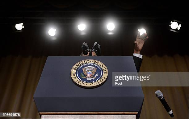 US President Barack Obama drops the microphone after he speaks during the White House Correspondents' Association annual dinner on April 30 2016 at...