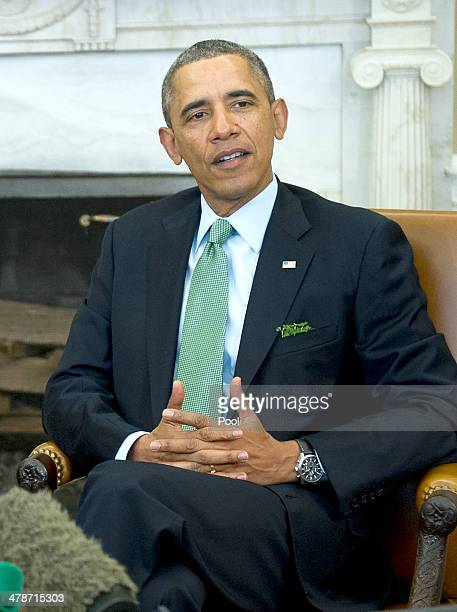 President Barack Obama during a meeting with Prime Minister Enda Kenny of Ireland in Oval Office of the White House on March 14 2014 in Washington DC...