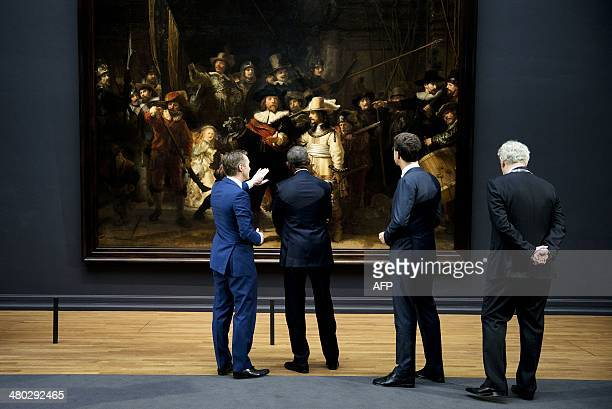 President Barack Obama , Dutch Prime Minister Mark Rutte and Amsterdam mayor Eberhard Van der Laan listen to Rijksmuseum director Wim Pijbes as he...