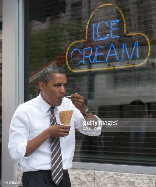 US President Barack Obama eats a mint chocolate chip ice cream cone after a surprise stop at Deb's Ice Cream and Deli in Cedar Rapids Iowa July 10...