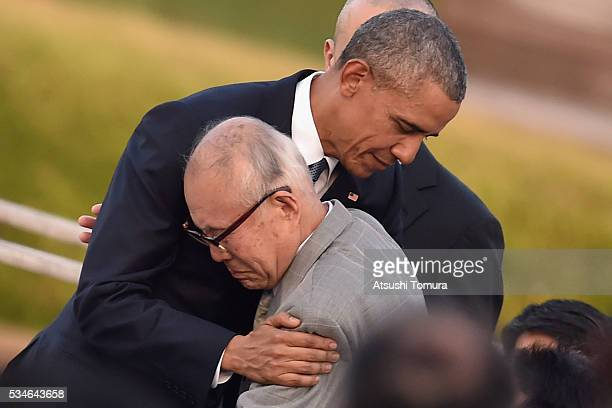 S President Barack Obama embraces an abomb victim at the Hiroshima Peace Memorial Park on May 27 2016 in Hiroshima Japan It is the first time US...