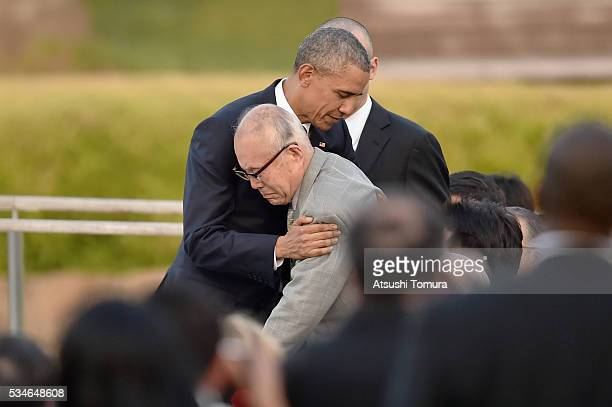 S President Barack Obama embraces atomic bomb survivor Shigeaki Mori during his visit to the Hiroshima Peace Memorial Park on May 27 2016 in...