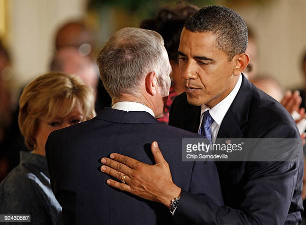S President Barack Obama embraces Dennis Shepard Matthew Shepard's father after delivering remarks following the enactment of the Matthew Shepard and...