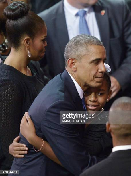 US President Barack Obama embraces Eliana Pinckney the daughter of the slain Rev and South Carolina State Sen Clementa Pinckney during his funeral at...