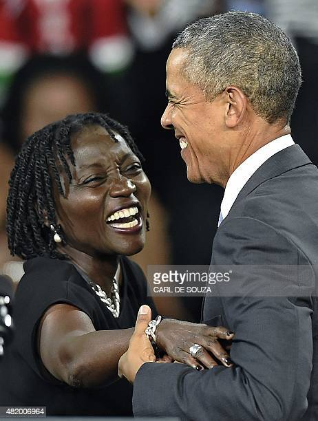 US President Barack Obama embraces his sister Auma at the Moi International Sports centre in Nairobi on July 26 2015 Obama arrived on July 24 in the...