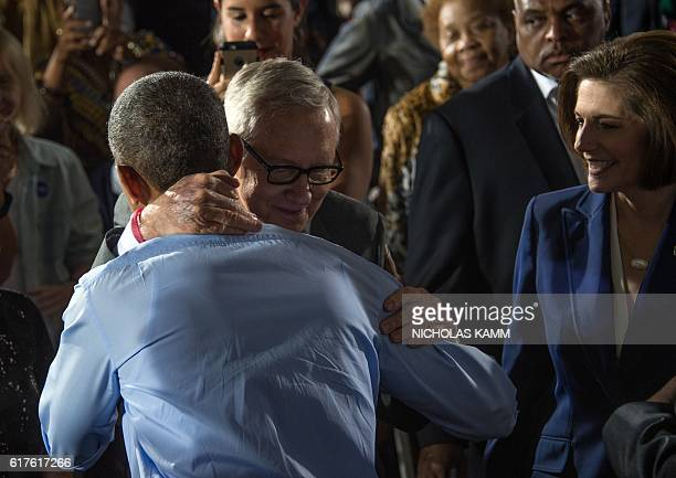 US President Barack Obama embraces US Senate Minority Leader Harry Reid after speaking at a campaign event for Democratic presidential candidate...
