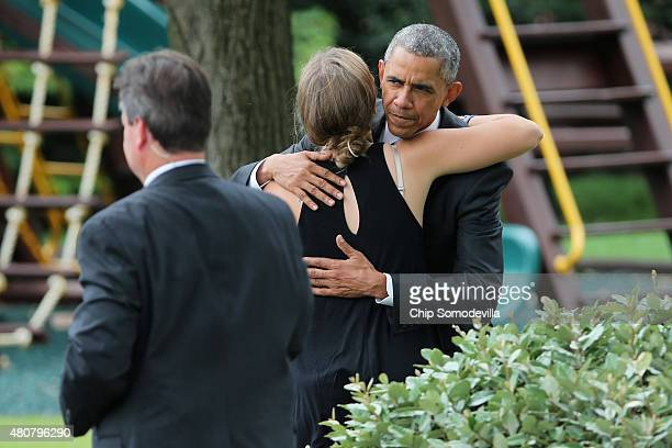 S President Barack Obama embraces Vice President Joe Biden's granddaughter Finnegan Biden before departing the White House on the South Lawn July 15...