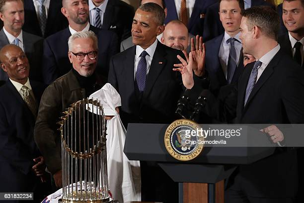 S President Barack Obama encourages people not to push his honorary 'fan' status during a celebration of the Major League Baseball World Series...