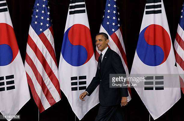 S President Barack Obama enter the hall for gives a lecture as he attends 2012 Seoul Nuclear Security Summit at the Hankuk University of Foreign...