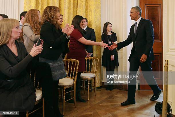 S President Barack Obama enters the East Room and greets victims of gun violence before delivering remarks about his efforts to increase federal gun...