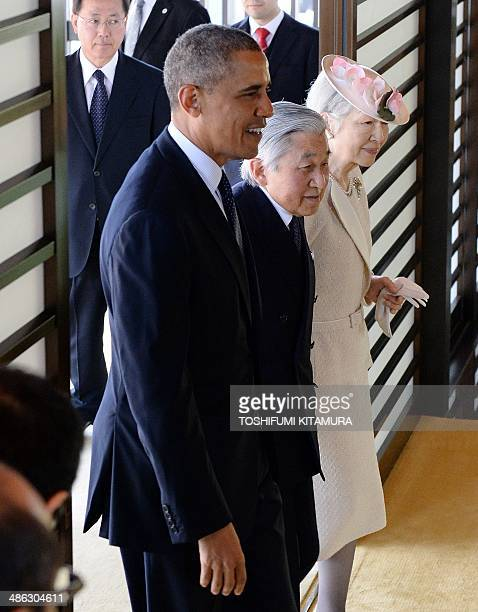 President Barack Obama enters the Imperial Palace with Emperor Akihito and Empress Michiko upon his arrival for a welcoming ceremony in Tokyo on...