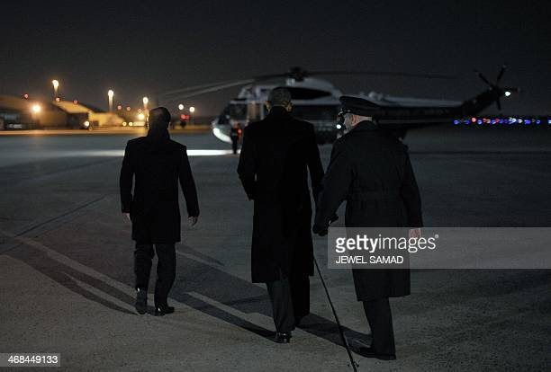 US President Barack Obama escorts his French counterpart Francois Hollande to the Marine One helicopter at Andrews Air Force Base in Maryland on...