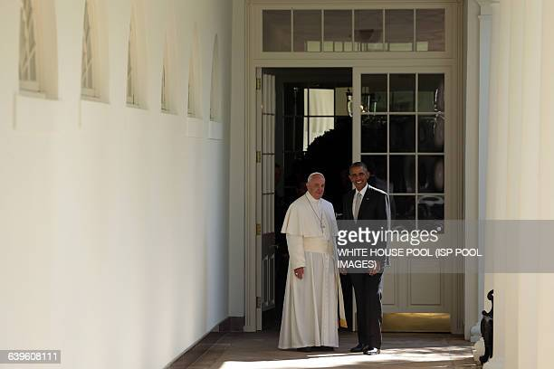 S President Barack Obama escorts Pope Francis down the West Wing colonnade walk during the arrival ceremony at the White House on September 23 2015...