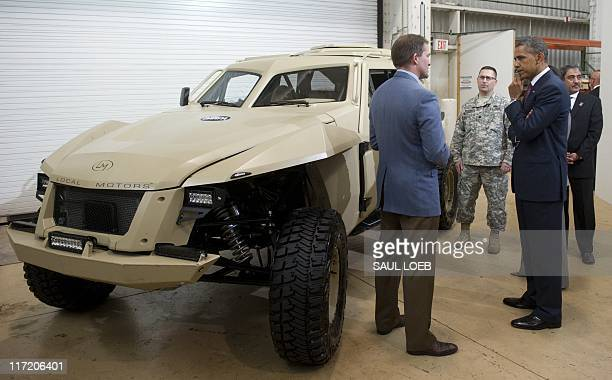 US President Barack Obama examines an XC2V vehicle developed by Local Motors in partnership with the Defense Advance Research Project Agency during a...