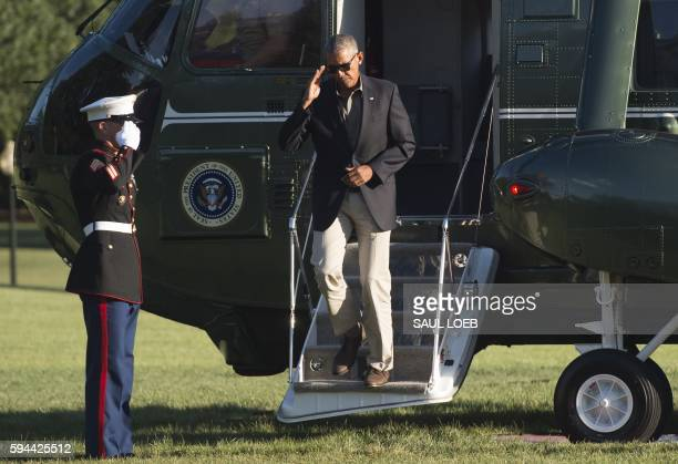 President Barack Obama exits Marine One upon arrival on the South Lawn of the White House in Washington, DC, August 23 after traveling to Baton...