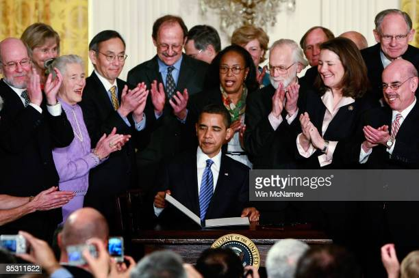 President Barack Obama finishes signing an Executive Order on stem cell research at the White House March 9, 2009 in Washington, DC. By signing the...