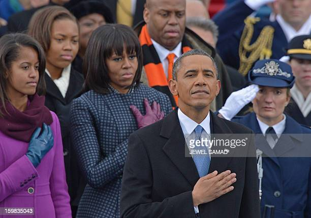 President Barack Obama First Lady Michelle and daughter Malia listen to Beyonce sing the National Anthem during the 57th Presidential Inauguration...